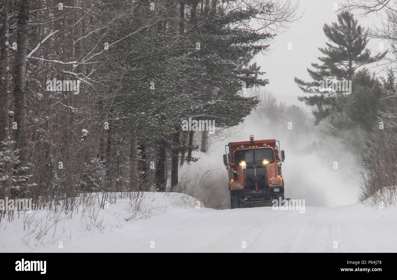 Plow truck on Fontinalis road, Otsego County, winter 17-18. - Stock Image