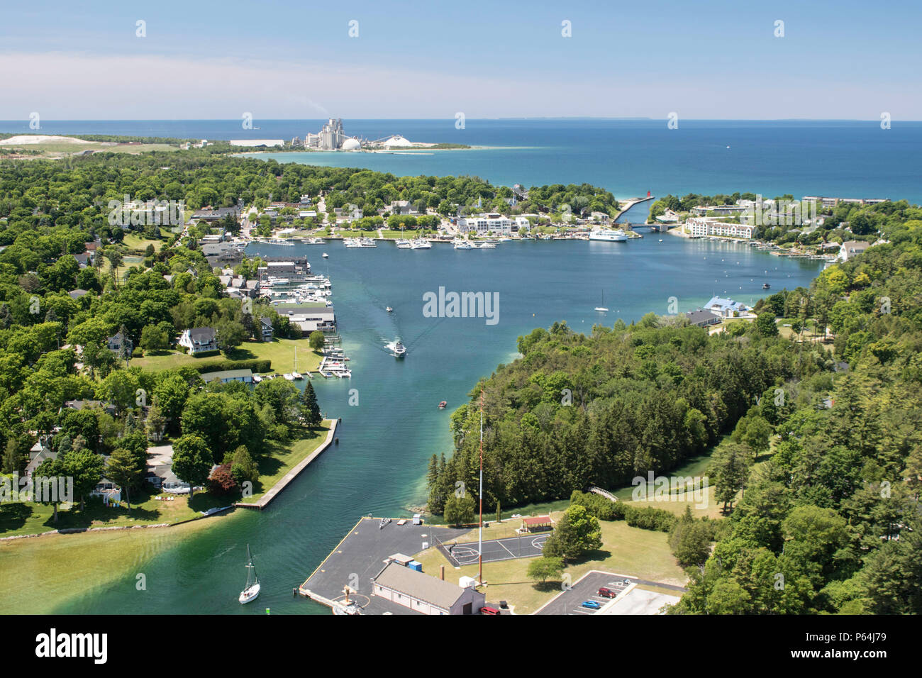 Aerial view of the Pine River leading to Round Lake with Charlevoix and Lake Michigan in the background, looking west. - Stock Image