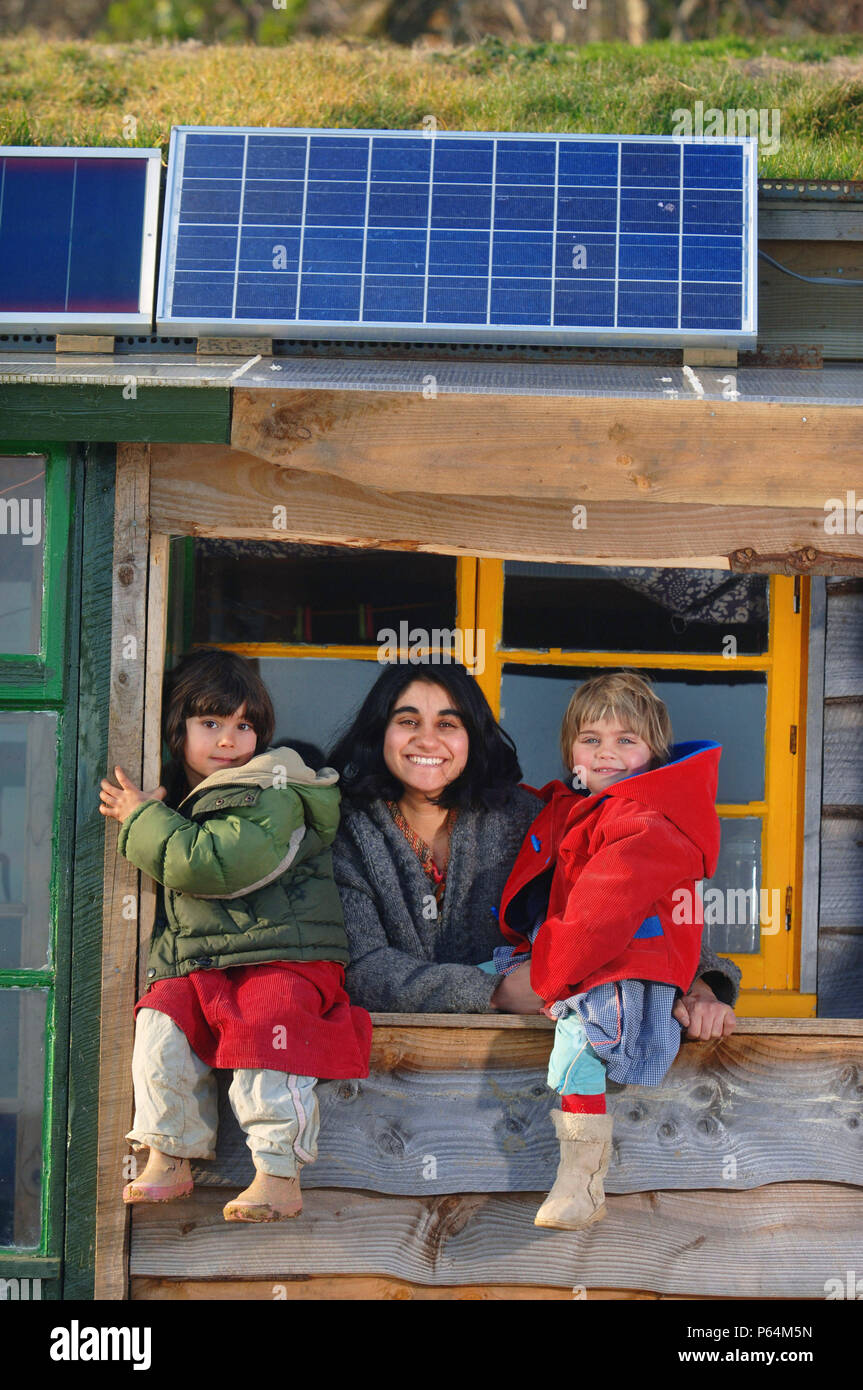 Jyoti Fernandes & family at their self sufficient home fitted with solar panels - Penny Farm, Dorset, UK - Stock Image