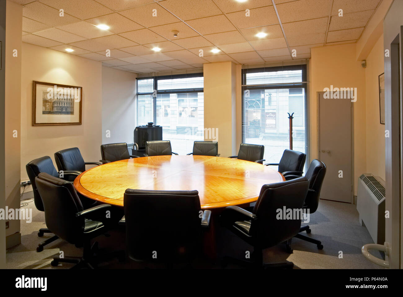 Office meeting room with round table Stock Photo - Alamy
