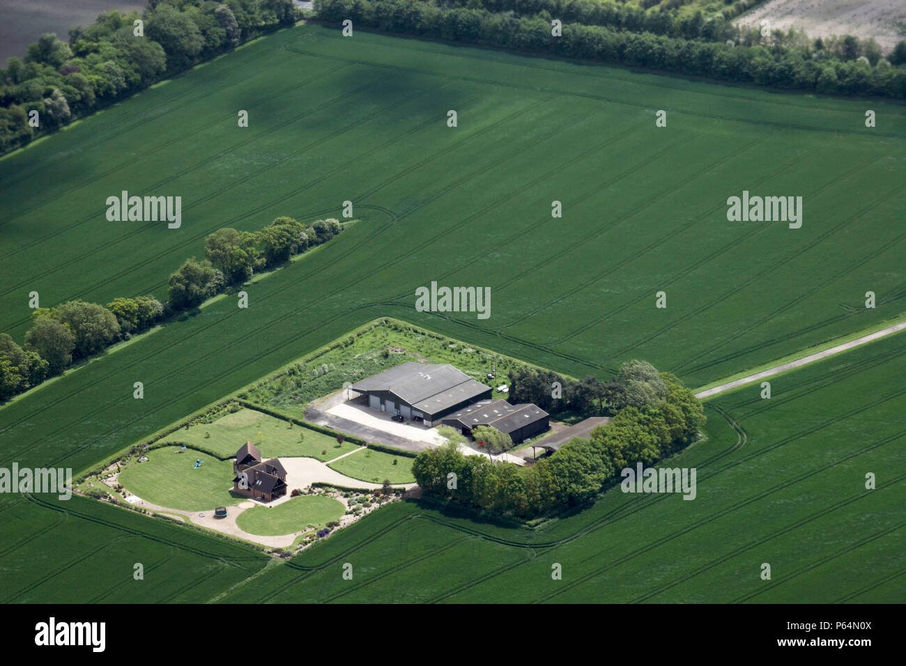 aerial view south of farm building barn and residential house inaerial view south of farm building barn and residential house in chilton oxfordshire, uk