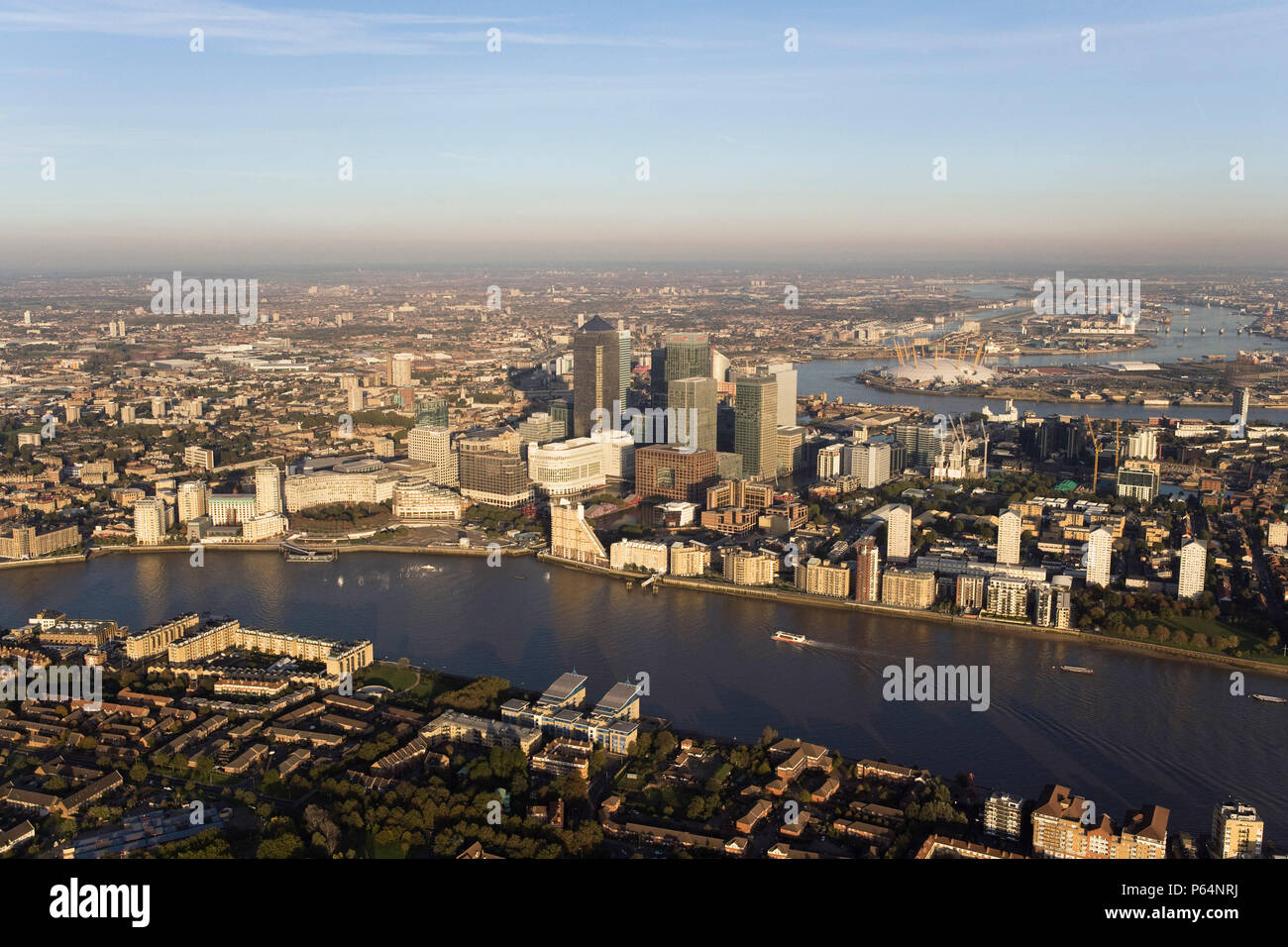 Aerial view of Canary Wharf, Docklands, London, UK. River Thames in foreground Stock Photo