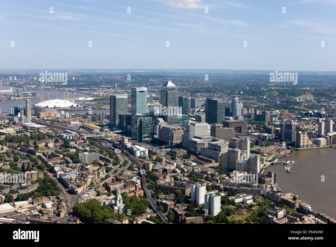 Aerial view of Canary Wharf, Docklands, London, UK. Also known as Isle of Dogs. Millennium Dome and Thames Barrier in Stock Photo