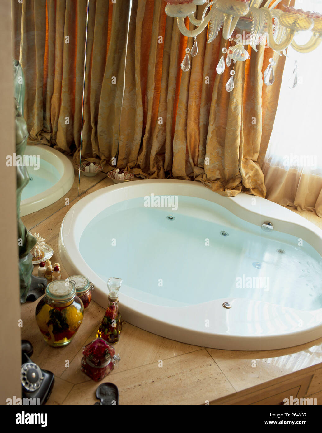 View of a bathtub filled with water - Stock Image
