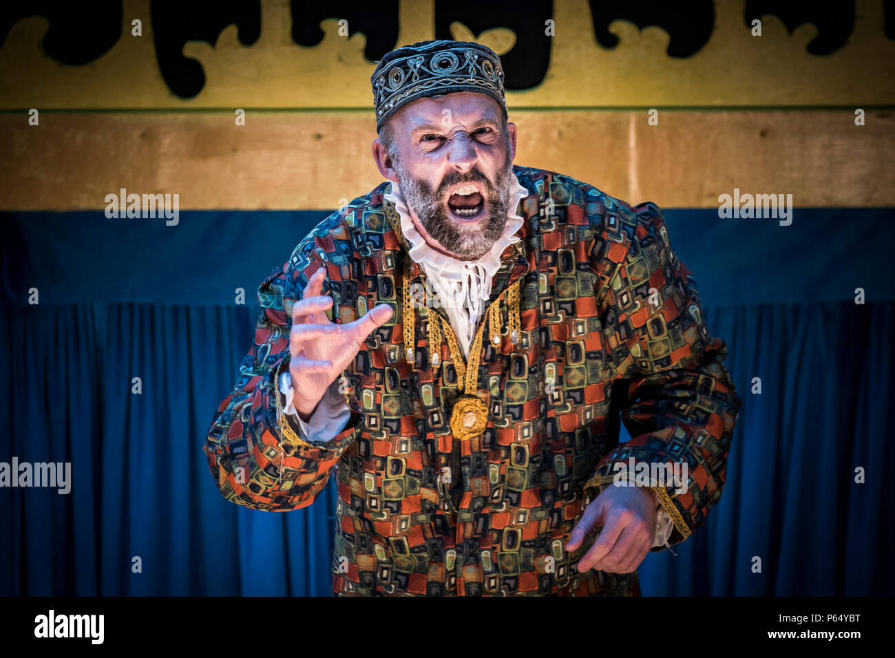 A performance of The Merchant of Venice by Illyria Theatre at Trebah Garden Amphitheatre in Cornwall. - Stock Image