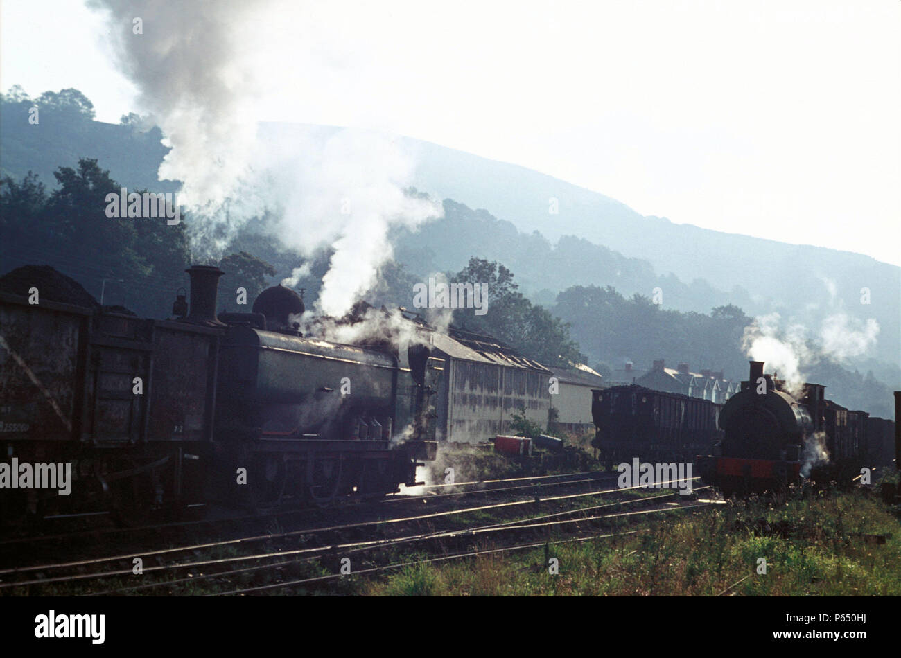 Welsh coalfield atmosphere at Mountain Ash Colliery with ex GWR main line 57XX Class Pannier Tank and Sir John, a personable 0-6-0ST built by Avonside - Stock Image