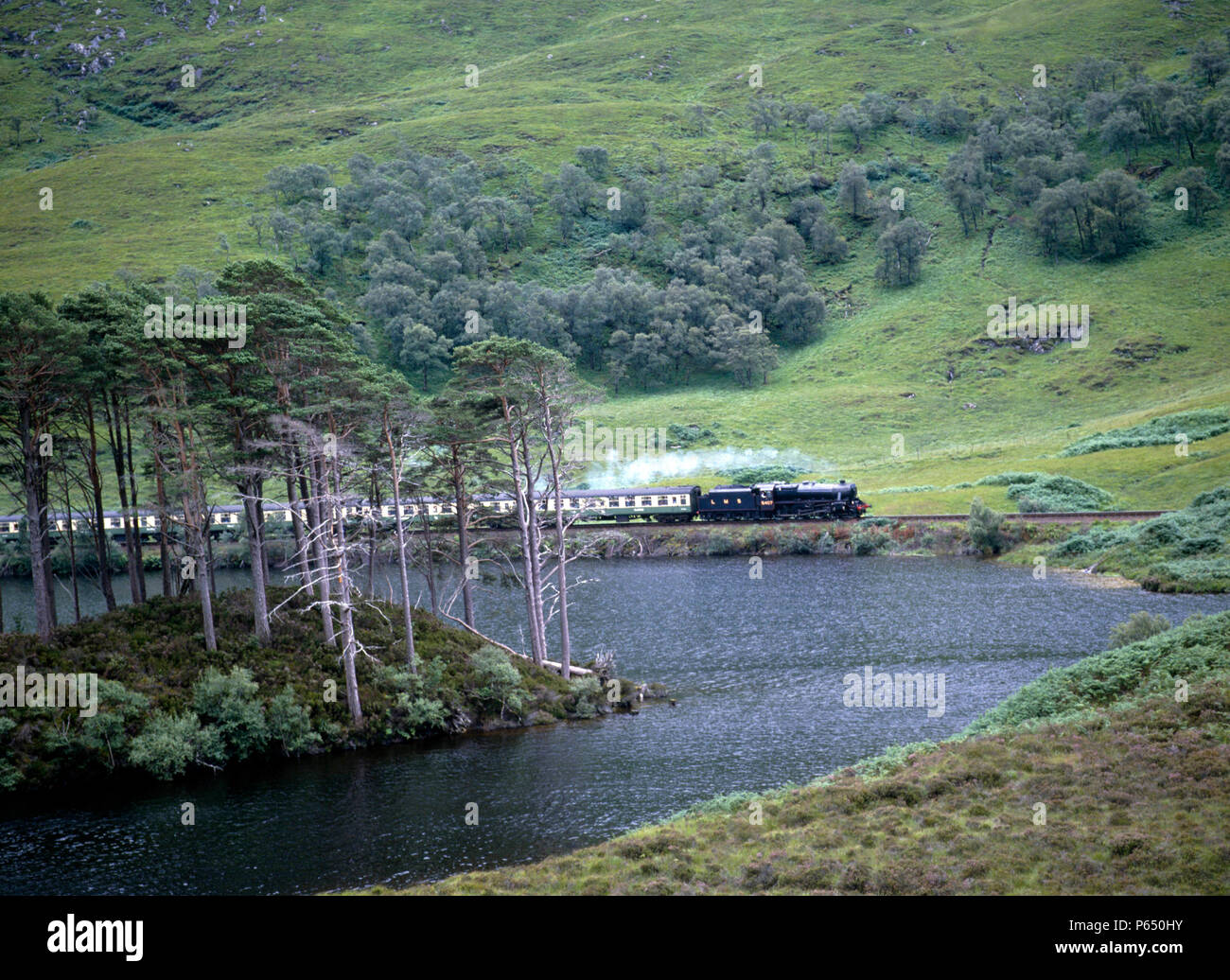 West Highlander, 5407 skirts Loch Eilt with the 11:05 ex Fort William for Mallaig. 11.08.85. - Stock Image