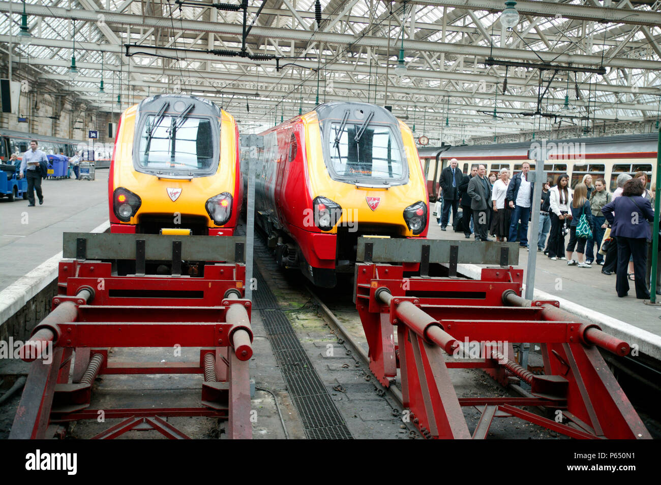 A brace of Virgin Voyagers stand at the buffer stops at Glasgow Central station. June 2005 - Stock Image
