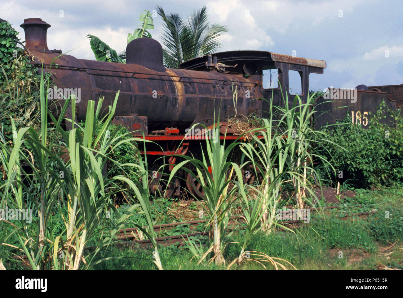 A Ghana Railway's 4-6-0 British built by Robert Stephenson of Newcastle lies abandoned in Location Works 1985. - Stock Image