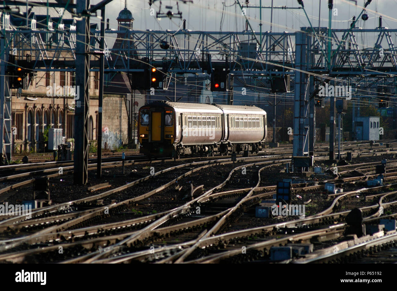 A local service from Edinburgh via Shotts approaches Glasgow Central. November 2004. - Stock Image