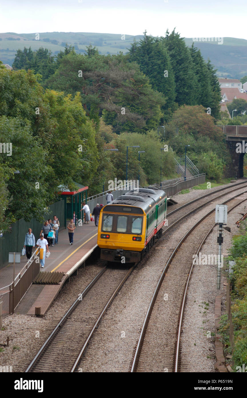 A Maesteg - Corytown local train calls at Pencoed to collect passengers. September 2004. - Stock Image