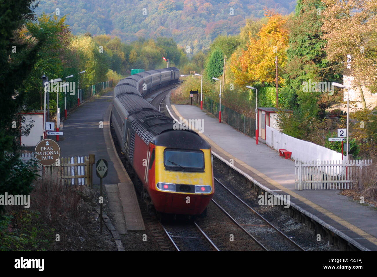 A Midland Mainline HST Rio service heads north through the Peak District National Park as it passes through Grindleford Station. 2004 - Stock Image