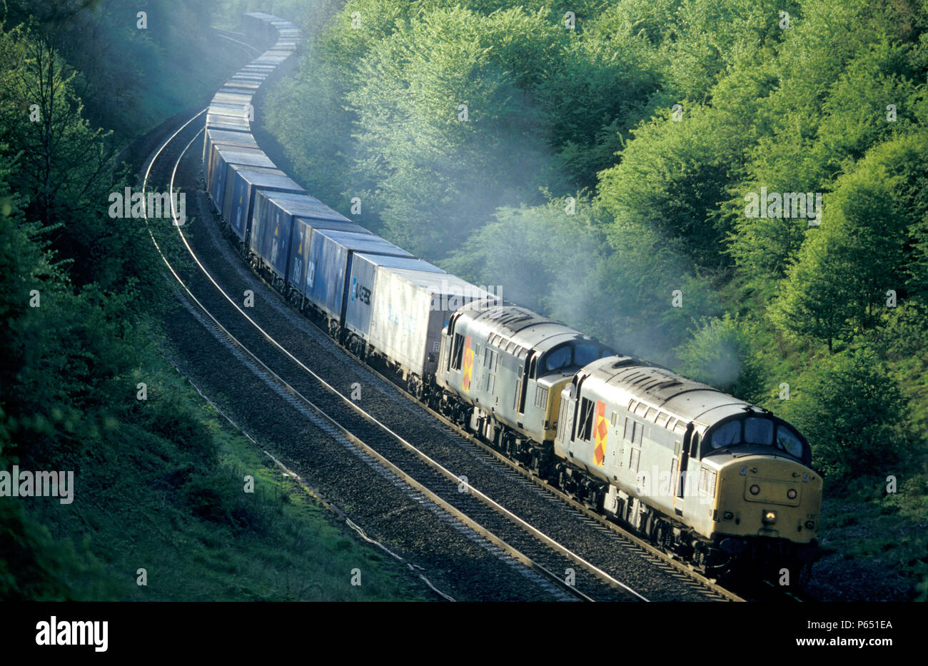 A pair of Class 37 diesel electrics double head a container freight through Harbury Cutting near Leamington en route from Southampton docks C 1992 - Stock Image