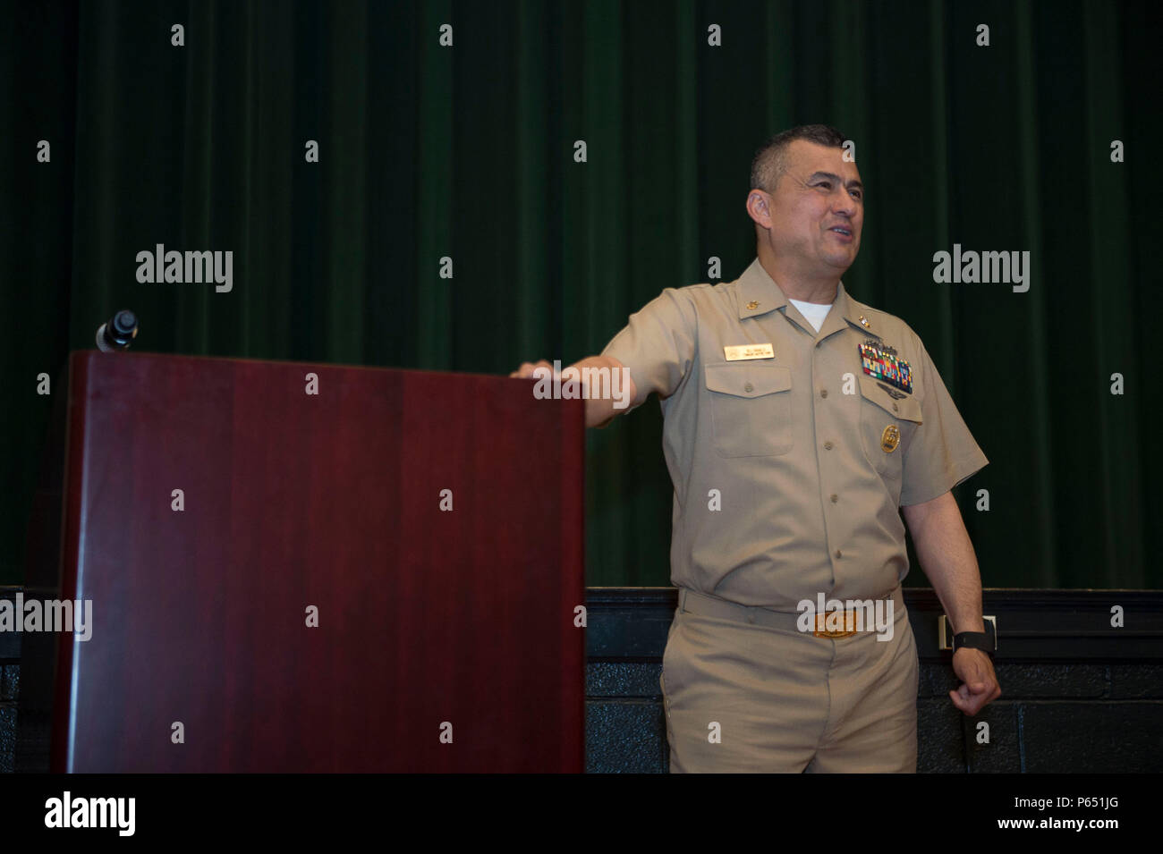 160511-N-TA425-293 NORFOLK (May 11, 2016)  Naval Station Norfolk Command Master Chief William Carabollo speaks at the ninth annual First Class Petty Officer Association (FCPOA) Symposium.  FCPOA established the event as a way to help Sailors further their careers, network and get leadership guidance. (U.S. Navy photo by Mass Communication Specialist 2nd Class Erica Yelland/Released) - Stock Image