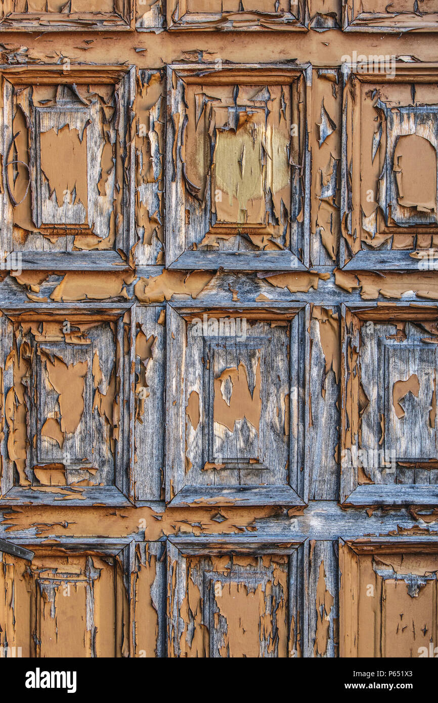 old door with scratched paint. - Stock Image