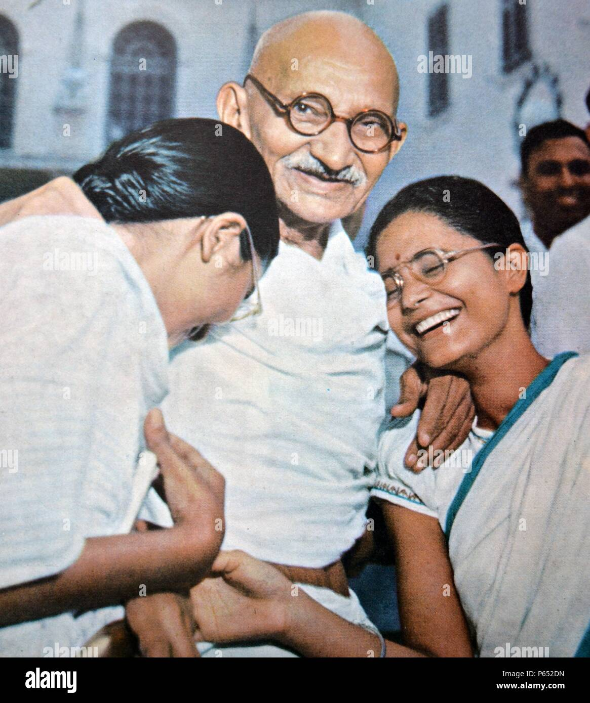 Mohandas Karamchand Gandhi (2 October 1869 – 30 January 1948)  leader of Indian nationalism in British-ruled India with two of his neices - Stock Image