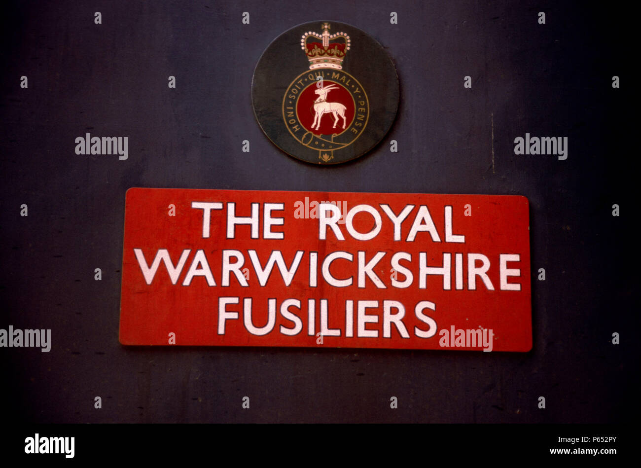Nameplate and badge on locomotive The Royal Warwickshire Fusiliers. C1993 - Stock Image