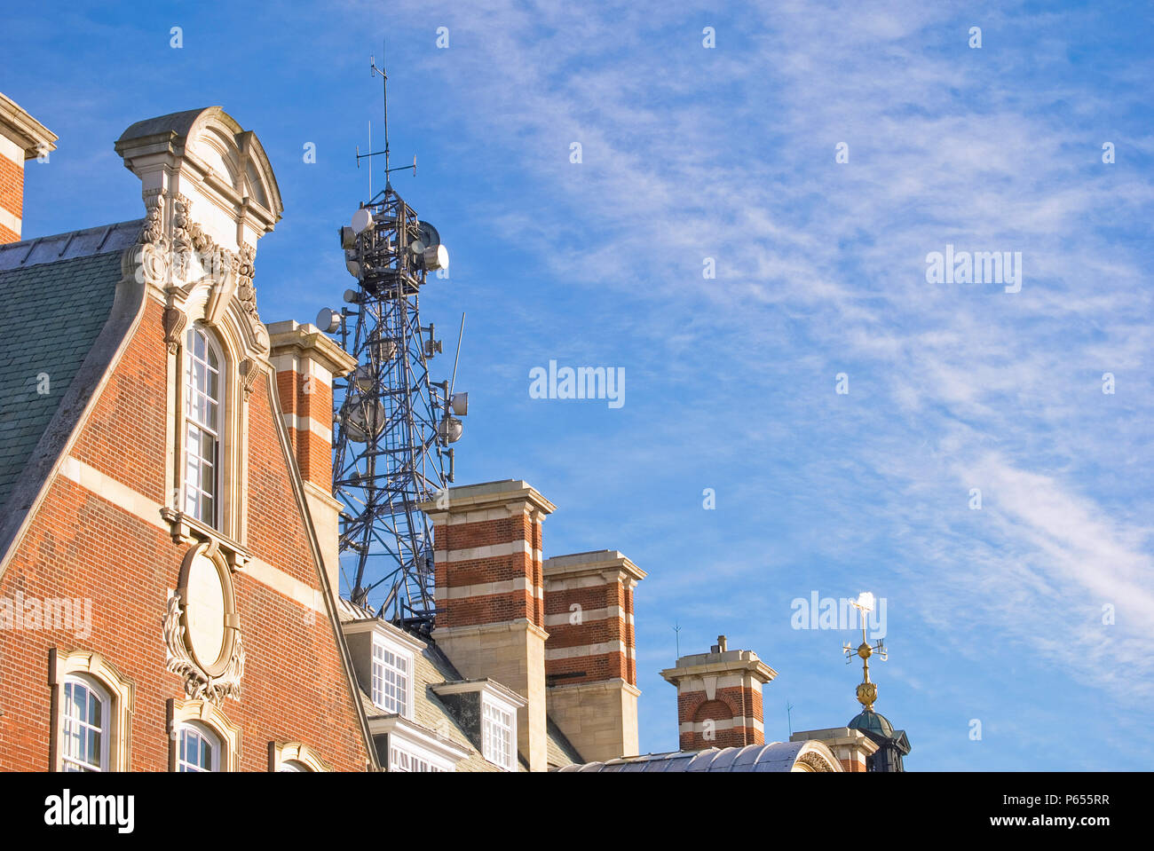 Communications tower atop building, York, United Kingdom - Stock Image