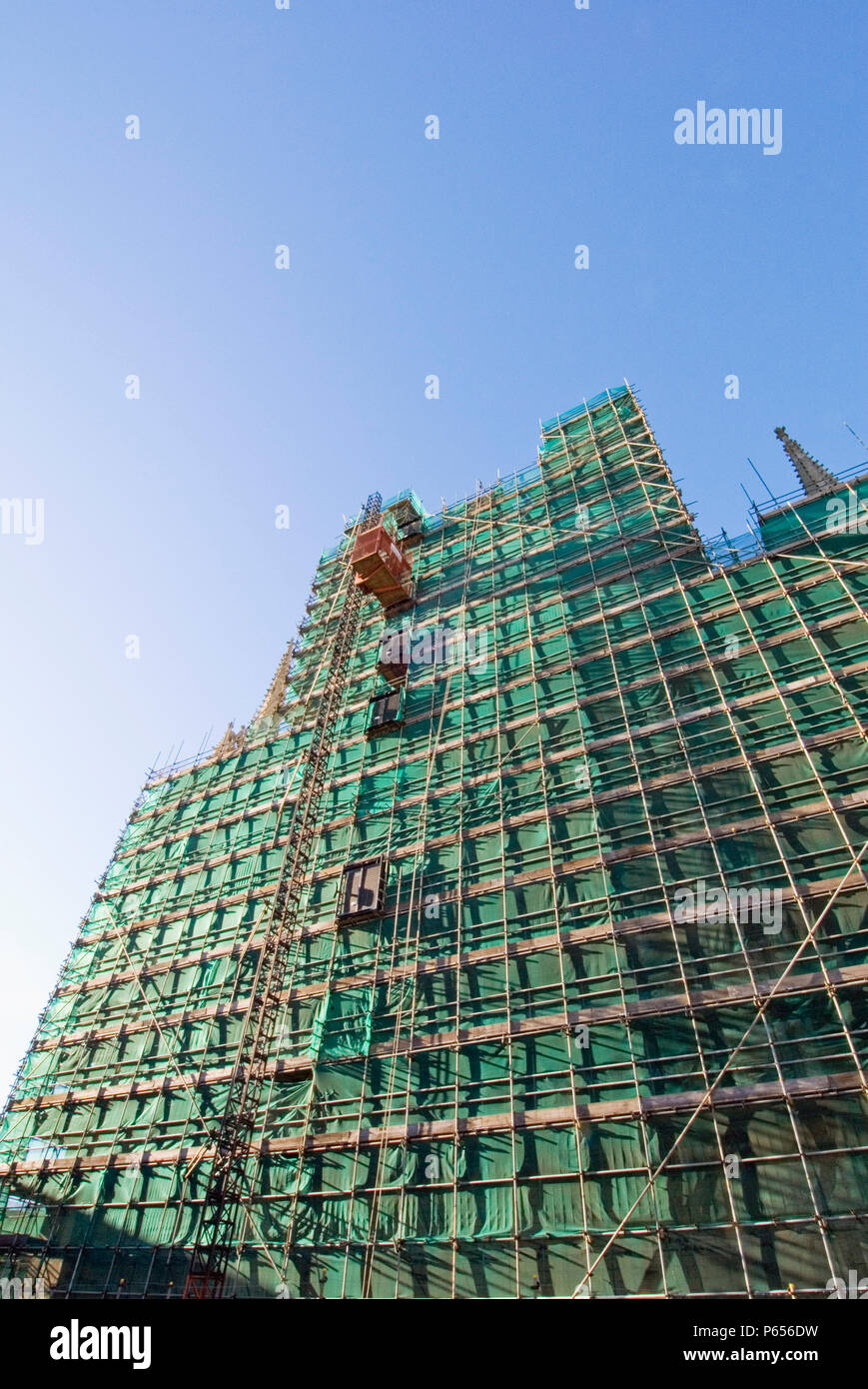 Safety netting and scaffold on East side of York Minster, York, United Kingdom - Stock Image