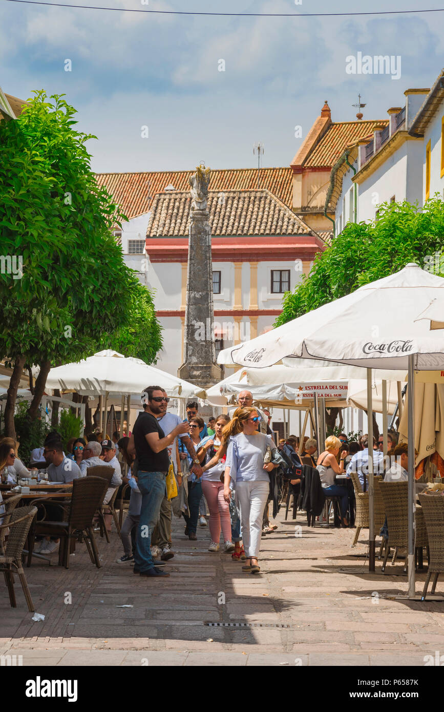 Cordoba cafe bar, view of people sitting outside cafes and bars in the popular Calle Enrique Romero Torres in the city of Cordoba, Andalucia, Spain. Stock Photo