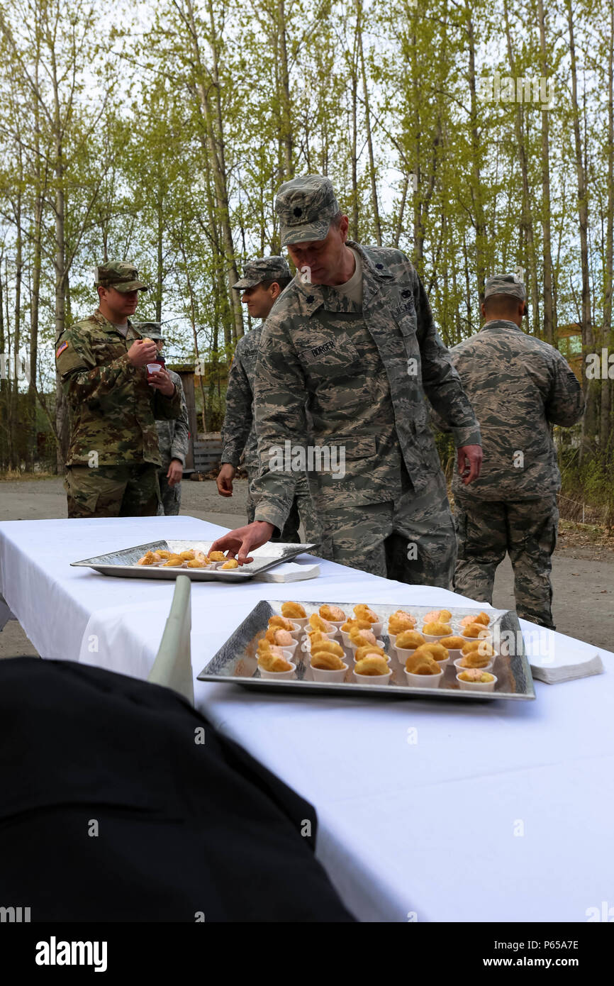 Lt. Col. Christopher Borger, human resources supervisor for Joint Forces Headquarters, Alaska National Guard, samples the salmon mouse and puff pastry during the Alaska Native cultural event at the Alaska Heritage Center in Anchorage on May 4. The occasion included Alaska Native food samplings and dance performances, Alaska Native artists, cultural exhibits and craft activities. (U.S. Army National Guard photo by Sgt. Marisa Lindsay) - Stock Image