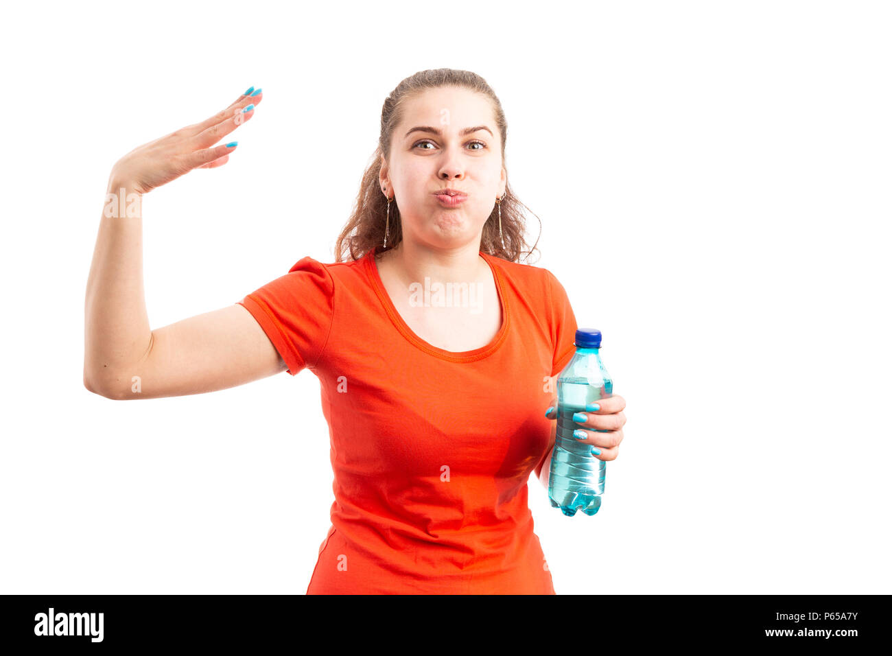 Young woman suffering health problem from high temperature heat holding bottle of water and making hot gesture as overheat concept isolated on white b - Stock Image