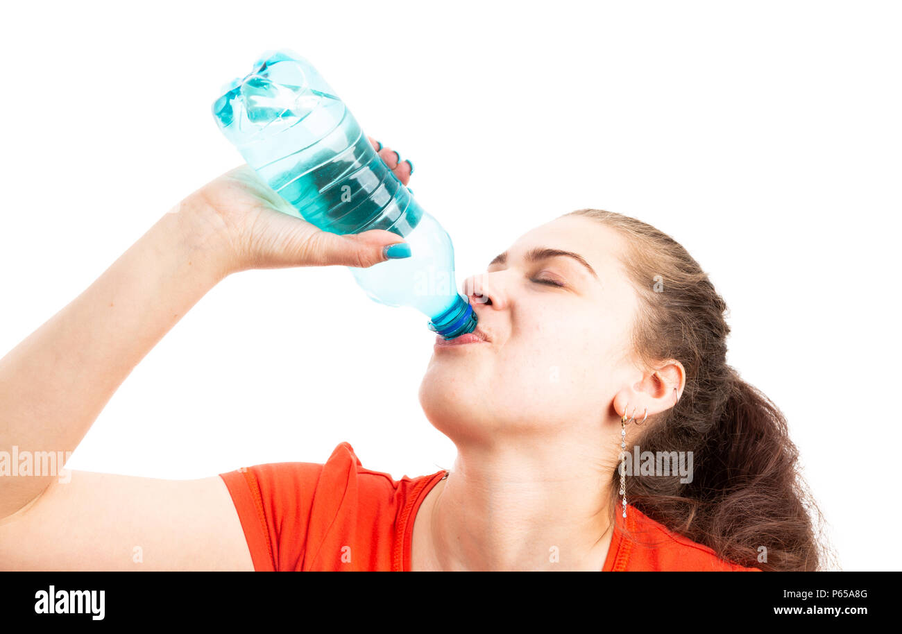 Young woman refreshing by drinking water from plastic bottle as cooling hydration in hot weather concept isolated on white background - Stock Image