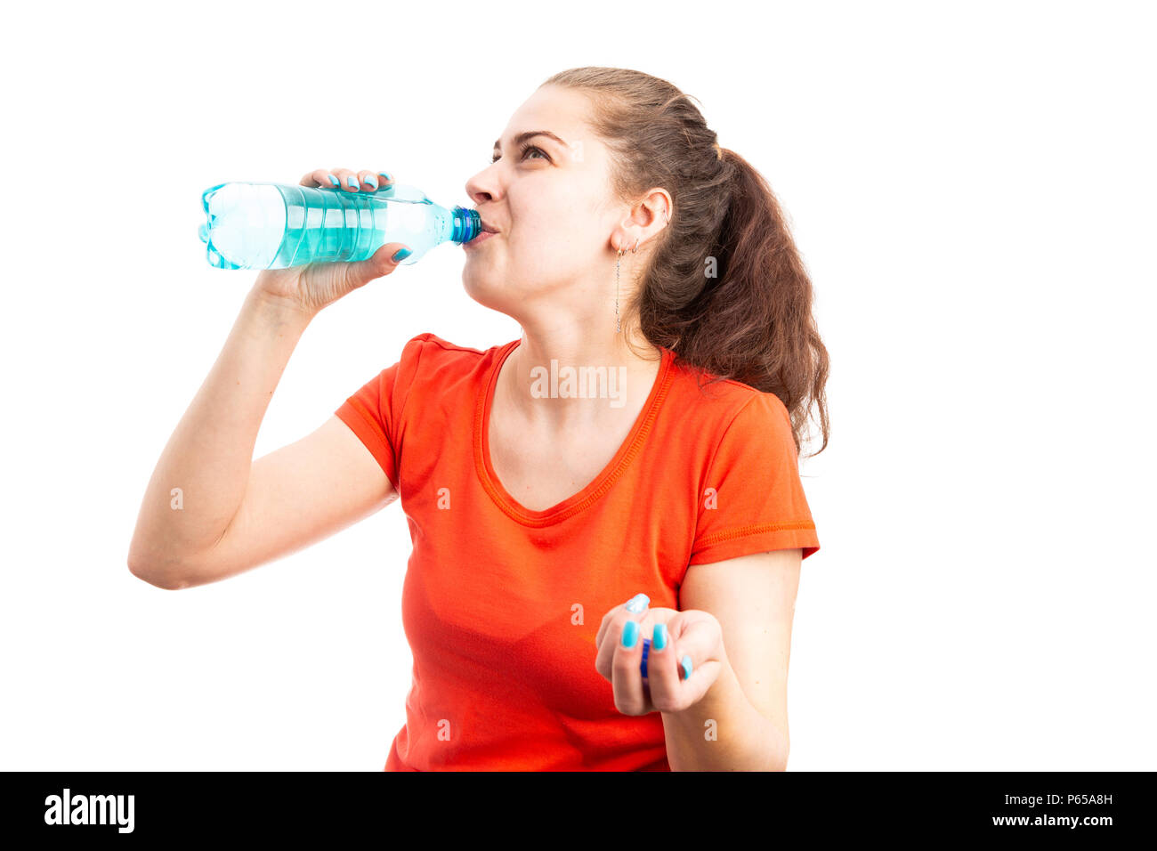 Young woman hydrating by drinking water from bottle as summertime hot weather hydration concept isolated on white background - Stock Image