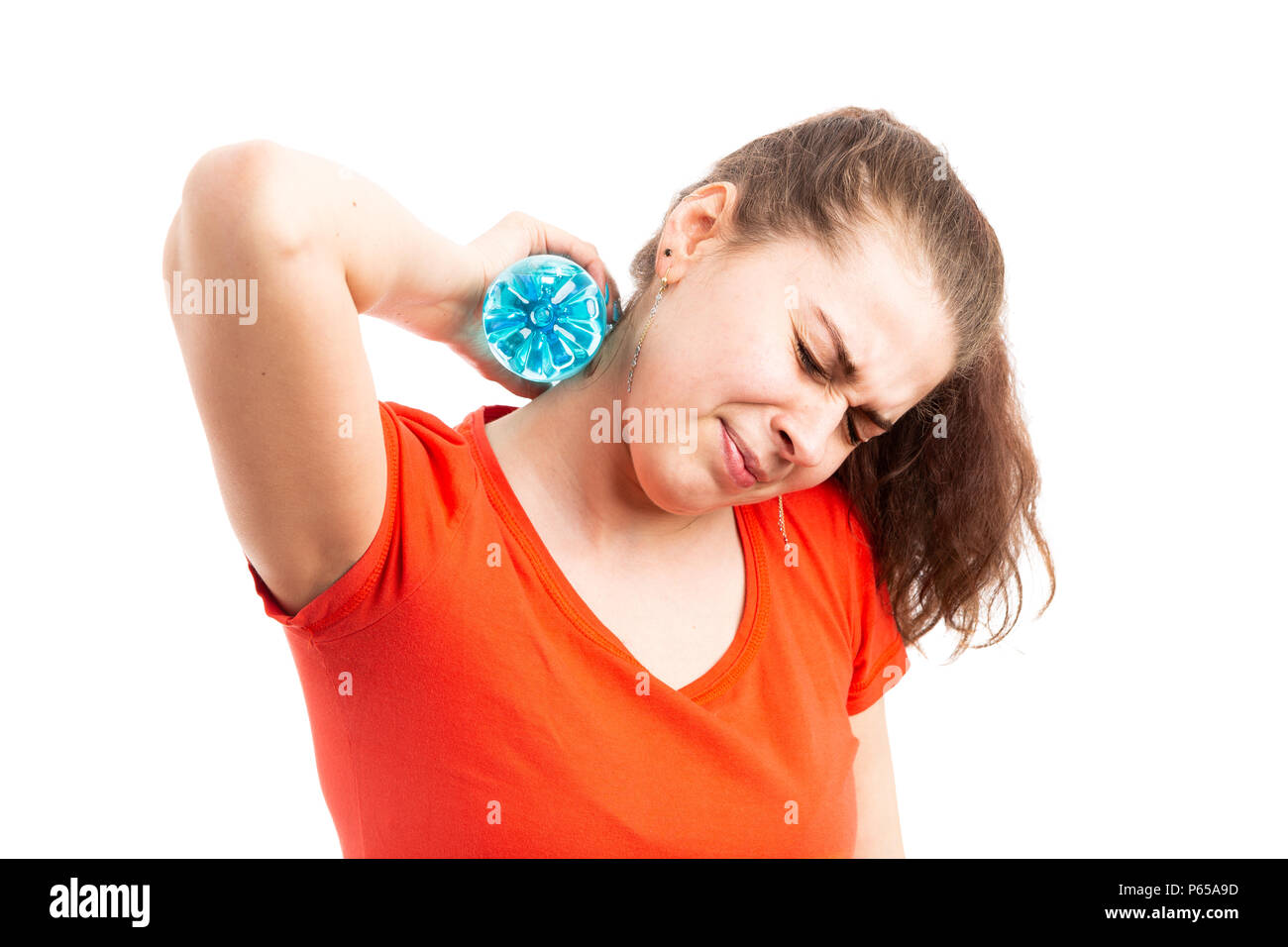 Young woman suffering from hot weather cooling with water bottle touching her neck as medical high temperature problem concept isolated on white backg - Stock Image