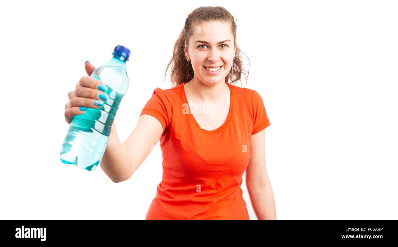 Attractive young woman smiling and offering bottle of water as summertime weather hydration concept isolated on white background - Stock Image