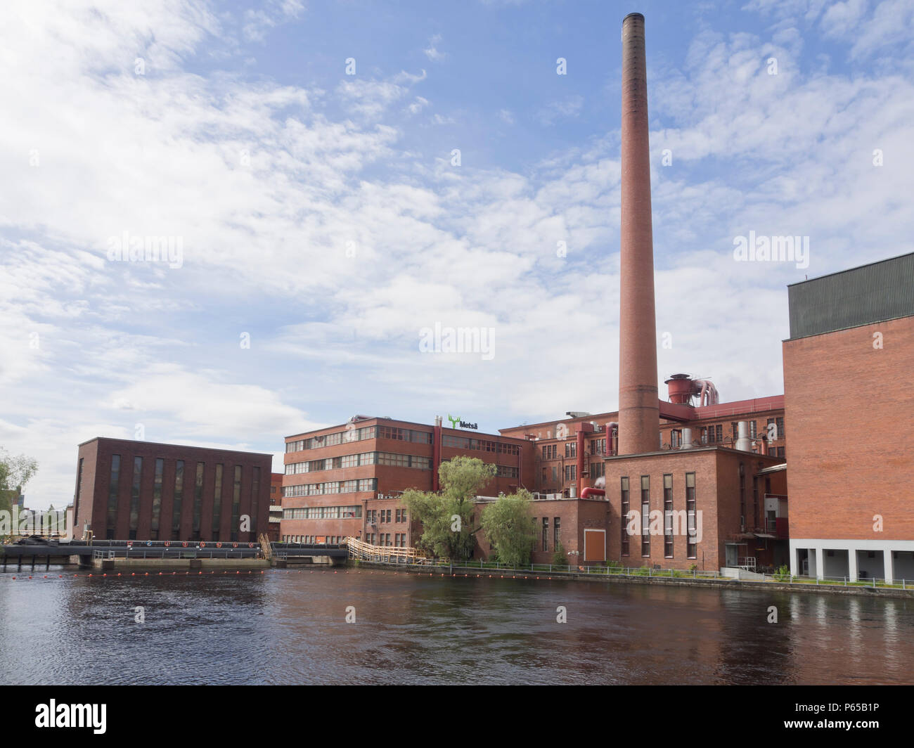 The old power station and industrial architecture along the Tammeroski river in Tampere Finland Stock Photo