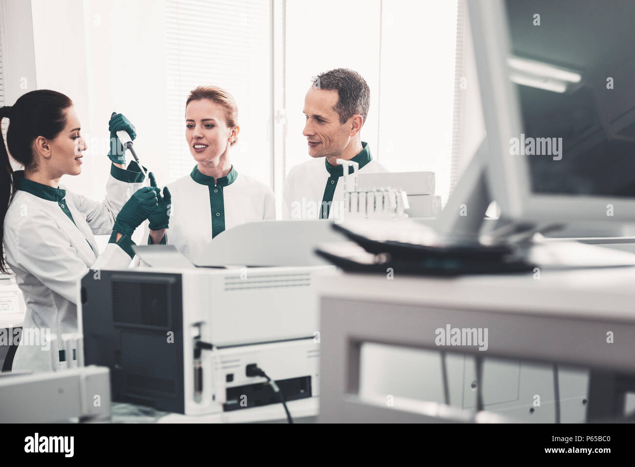 Professional doctors teaching their assistant - Stock Image