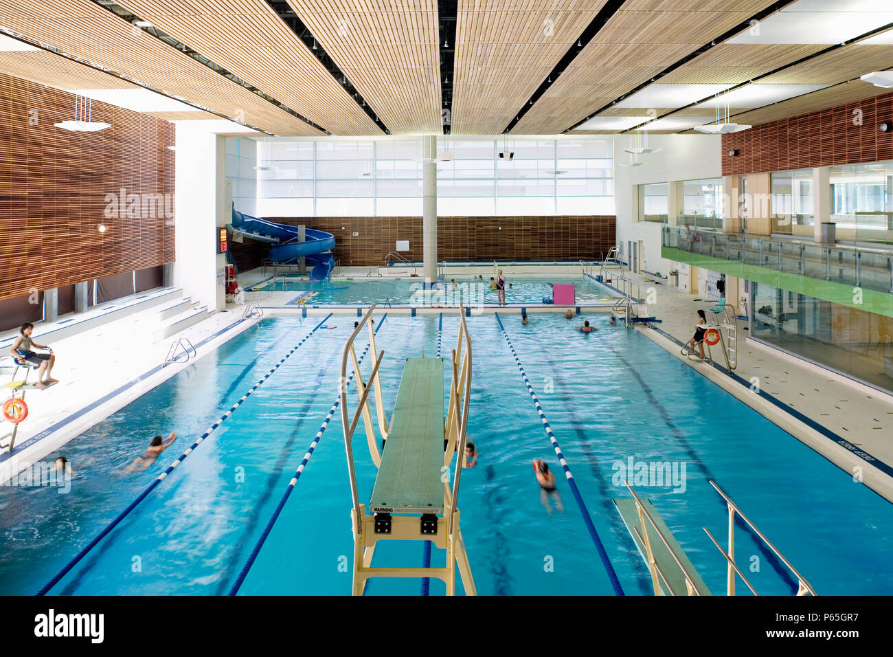 Indoor Swimming Pool With Diving Board Stock Photos & Indoor