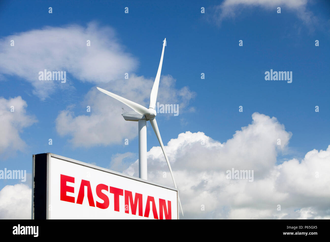 A 2 MW Wind turbine producing renewable electricity in the grounds of the Eastman factory on the outskirts of Workington, Cumbria, UK. There are 2 of  - Stock Image