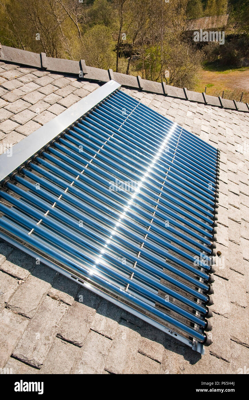 A solar panel water heater on a house roof in Ambleside, Cumbria, UK ...