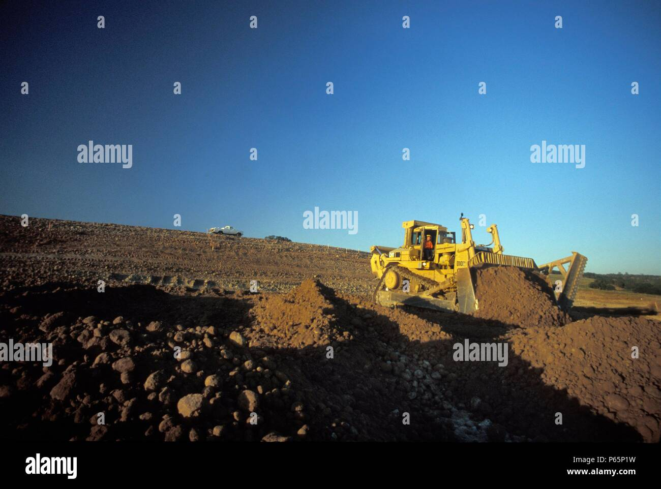Bulldozer moving dirt for large California housing development, USA Stock Photo