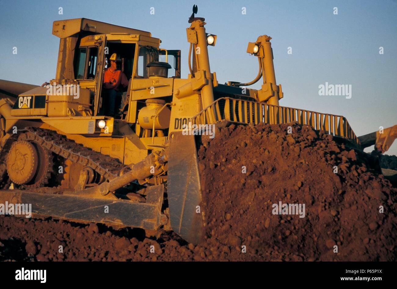 Bulldozer pushing dirt for large housing development in California< USA Stock Photo