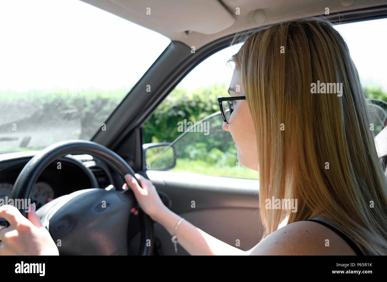 female teenage driver, driving motor vehicle, norfolk, england - Stock Image