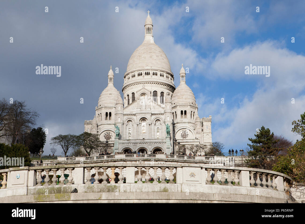 The Basilica of the Sacred Heart of Paris, commonly Sacré-Cœur Basilica overlooks the City of Paris and is one of it's major tourist hotspots Stock Photo