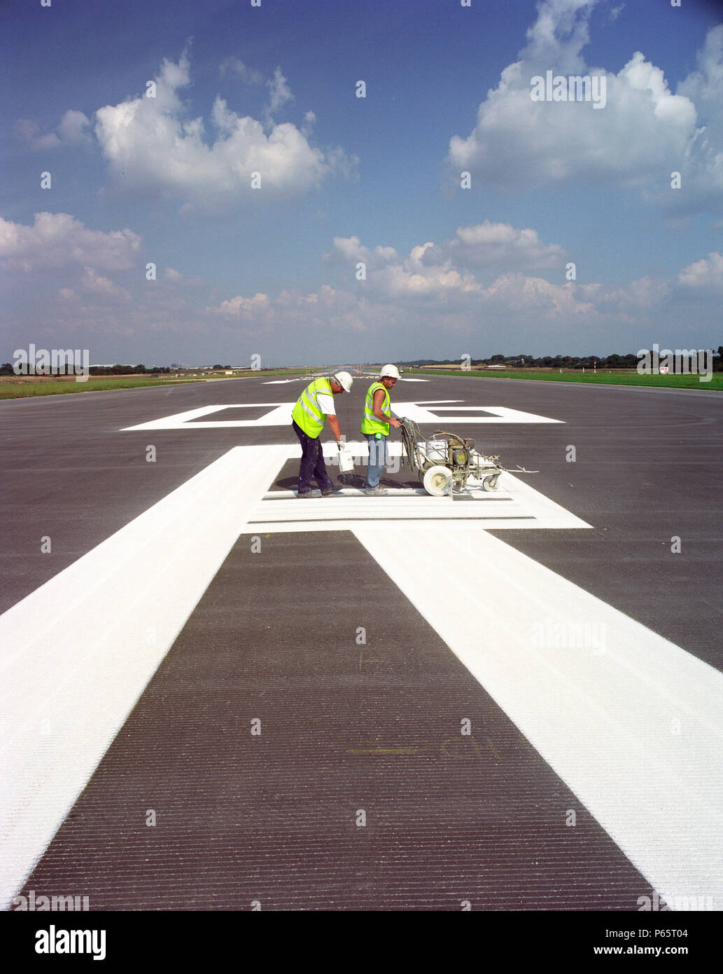 White lining at Manchester Airport's second runway - Stock Image
