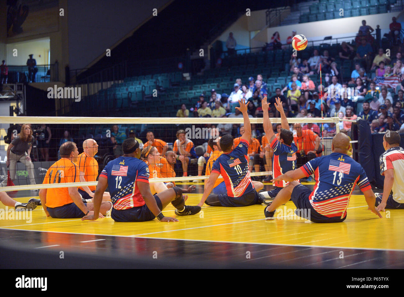 Athletes From Team Us And Netherlands Compete In The Sitting Volleyball Semi Finals During The 2016