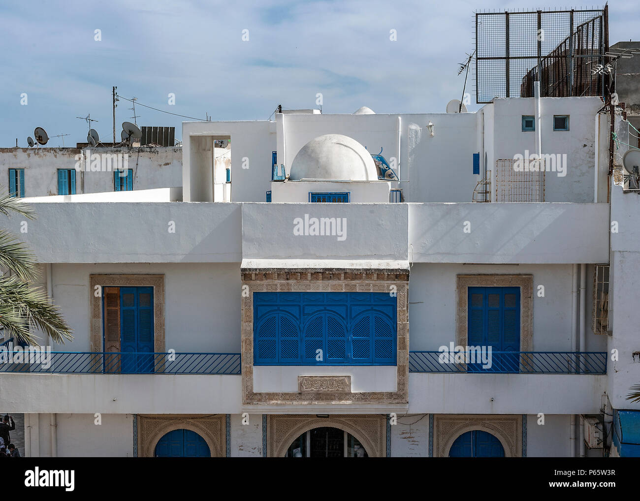 Tunisia, Sousse, the medina. Arab architecture abounds on the facades of balconies of various types, decorated with ornaments. Stock Photo