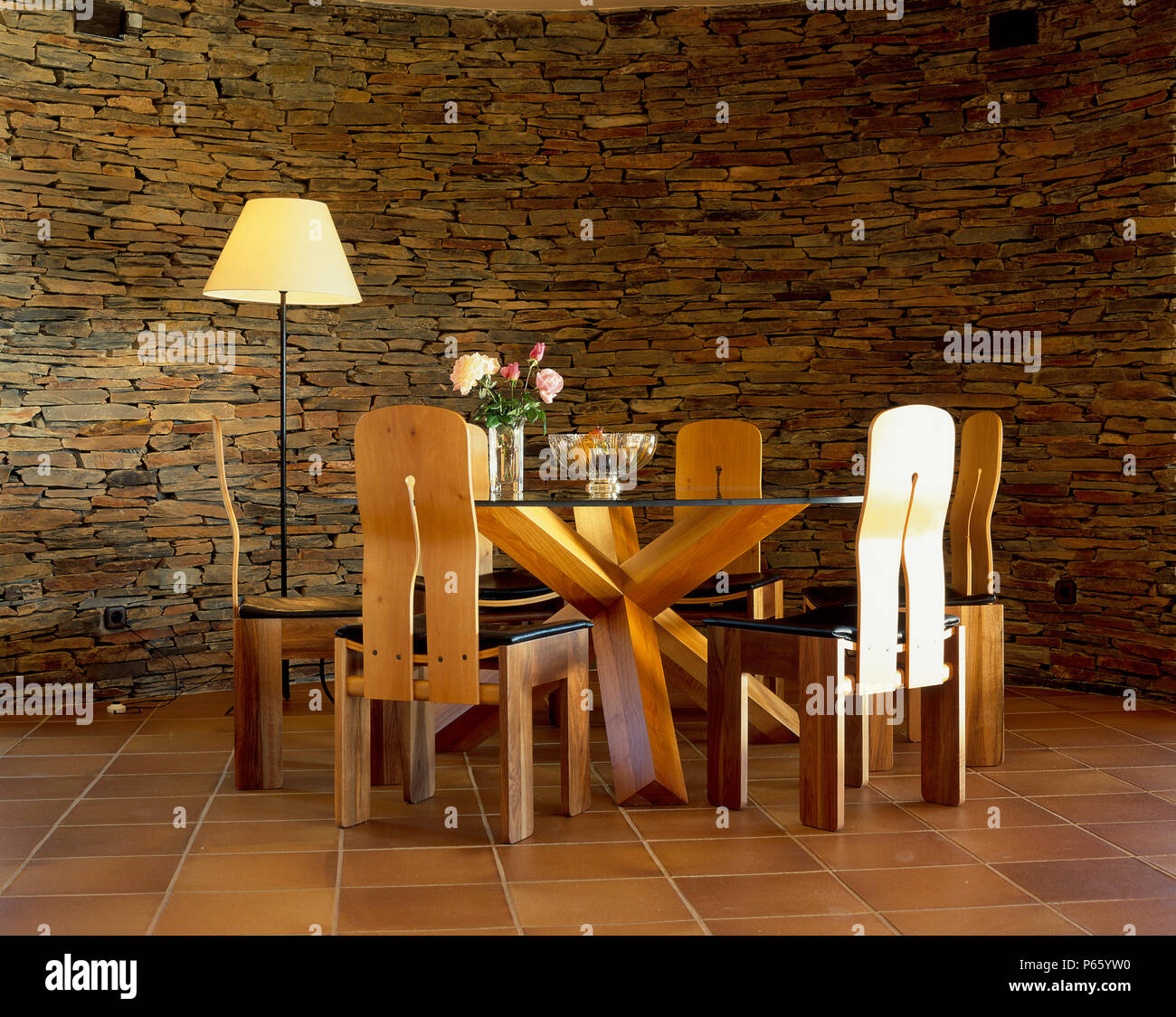 View Of A Dining Table Beside A Stonewall Stock Photo Alamy