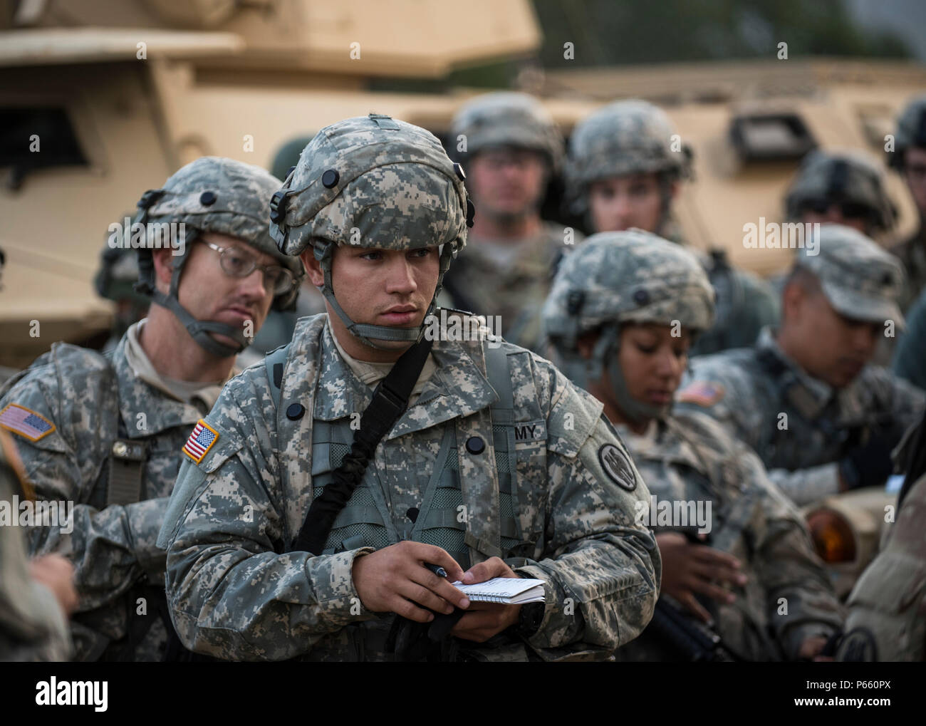 U S Army Reserve Military Police Soldiers From The 56th Military Police Company Combat Support Of Mesa Arizona Take Notes On A Mission Briefing Before Conducting A Cordon And Search Training Lane At