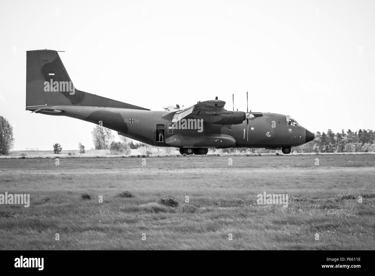 Landing of the military transport aircraft Transall C-160D. German Air Force. Black and white. Exhibition ILA Berlin Air Show 2018. Stock Photo