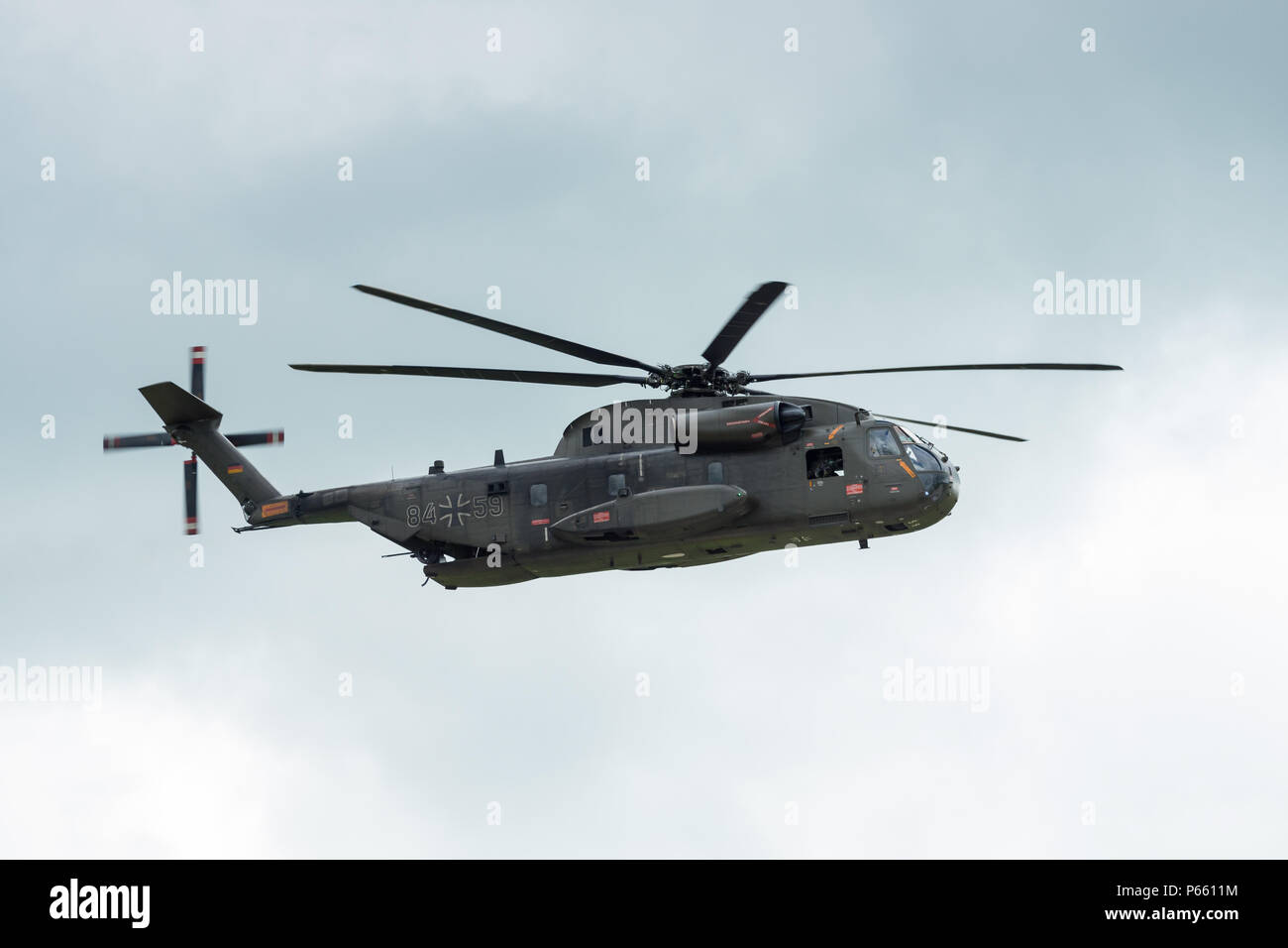 Demonstration flight of the medium utility military helicopter NHIndustries NH90. German Air Force. Exhibition ILA Berlin Air Show 2018. - Stock Image