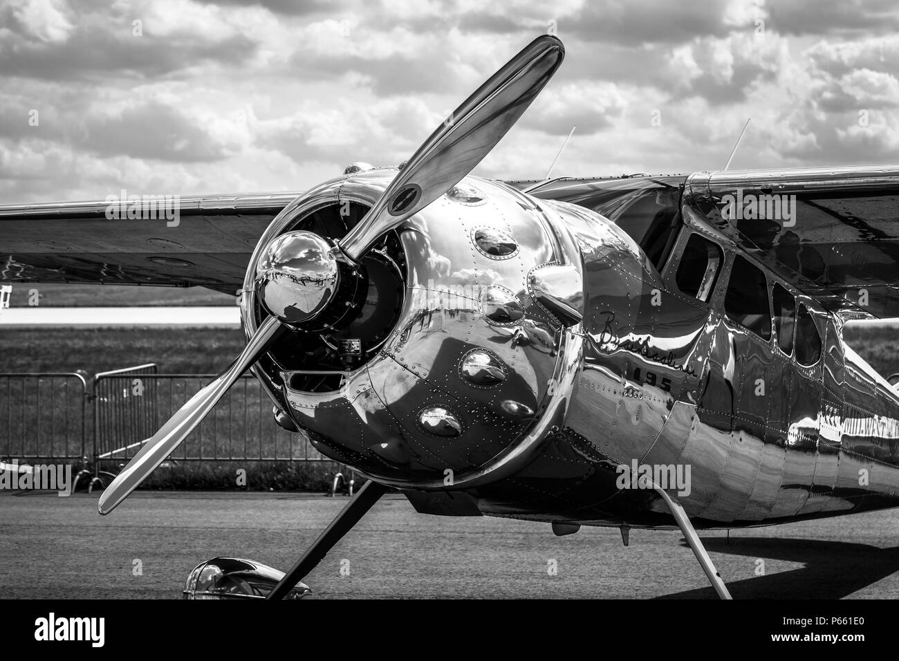 Light personal and business aircraft Cessna 195A by Mid-West Airlines on the airfield. Black and white. Exhibition ILA Berlin Air Show 2018. - Stock Image