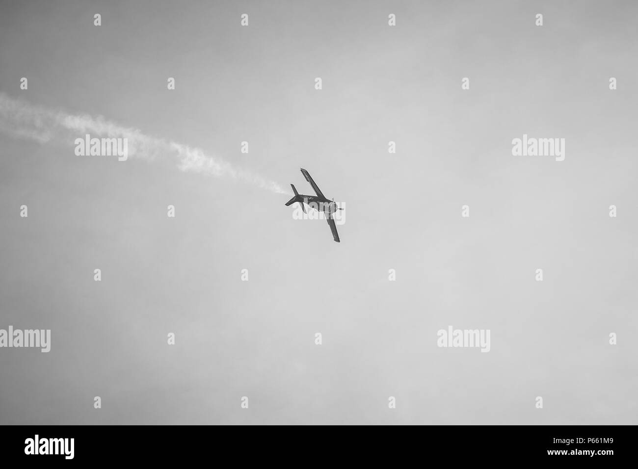 BERLIN - APRIL 27, 2018: Demonstration flight of light attack/trainer aircraft North American T-28B Trojan. Black and white. Exhibition ILA Berlin Air - Stock Image
