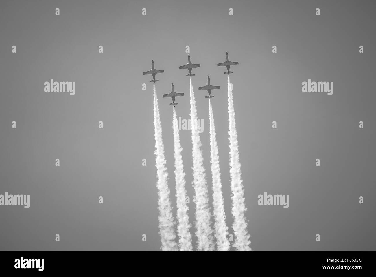 BERLIN, GERMANY - APRIL 28, 2018: Demonstration flight by the aerobatic team Patrulla Aguila (Eagle Patrol). Black and white. Exhibition ILA Berlin Ai - Stock Image