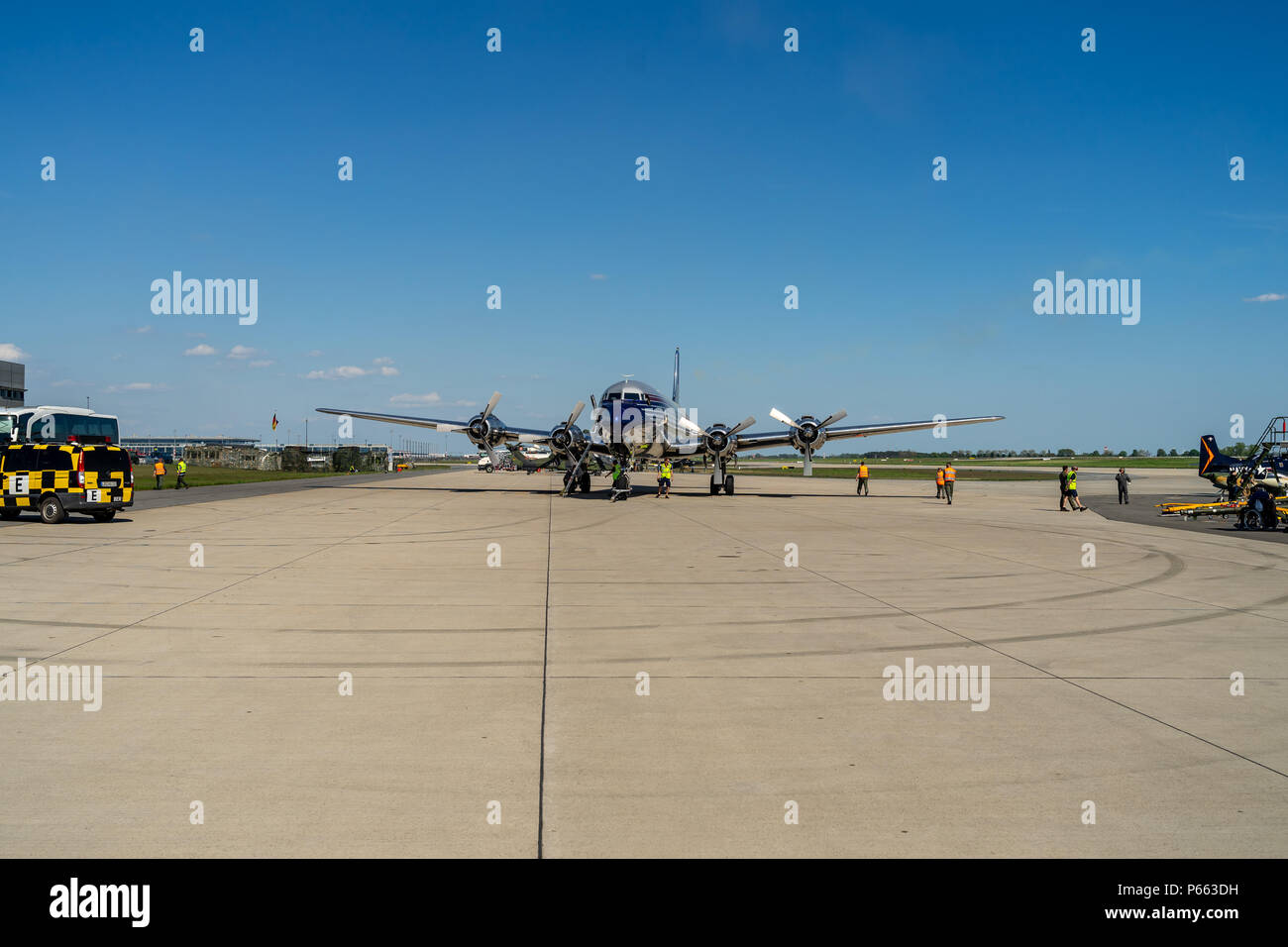 BERLIN - APRIL 28, 2018: The piston-powered airliner Douglas DC-6B on the airfield. Flying Bulls Team. Exhibition ILA Berlin Air Show 2018. - Stock Image
